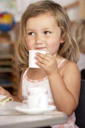 Young Boy Having Tea at MontessoriPre-School photo