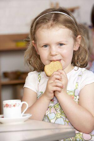 Young Girl Having Tea at Montessori/Pre-School Stock Photo - 5633376