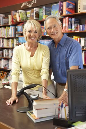 Couple running bookshop photo