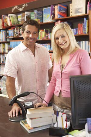 business couple: Couple running bookshop Stock Photo