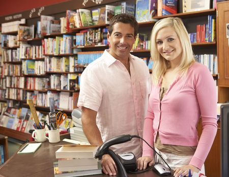Couple running bookshop photo