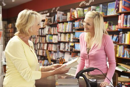 proprietor: Female customer in bookshop Stock Photo