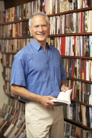 proprietor: Male customer in bookshop  Stock Photo