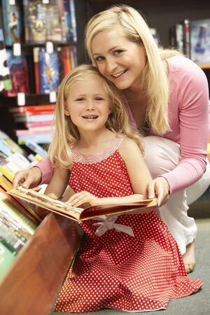 Mother and daughter in bookshop photo