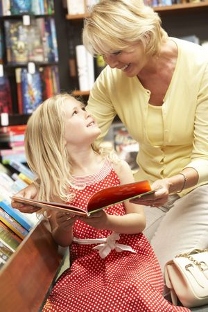 Grandmother and grandaughter in bookshop photo