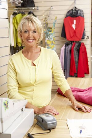 owner: Female sales assistant in clothing store