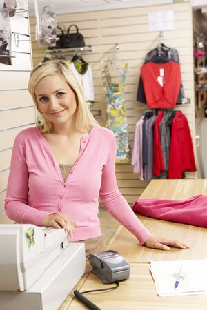 salesperson: Female sales assistant in clothing store