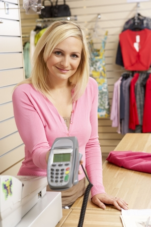 Female sales assistant in clothing store photo