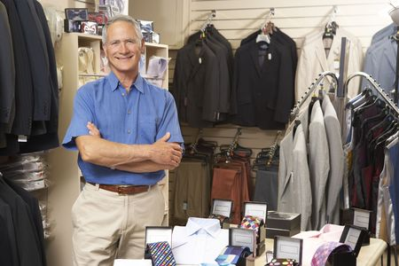 salesperson: Male sales assistant in clothing store