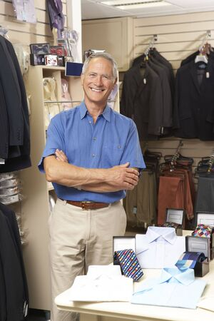 checkout stand: Male sales assistant in clothing store