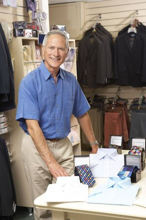 clothing store: Male sales assistant in clothing store