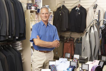 small business: Male sales assistant in clothing store