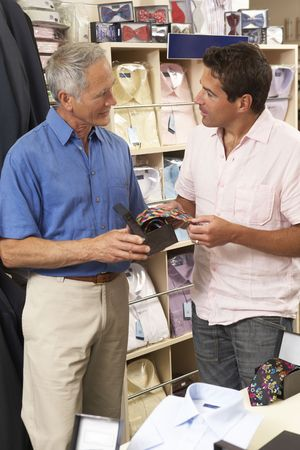 salesperson: Customer in clothing store with sales assistant Stock Photo