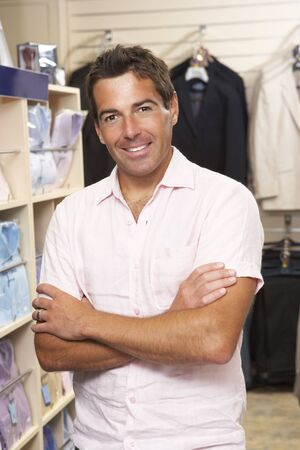 small business owner: Male sales assistant in clothing store