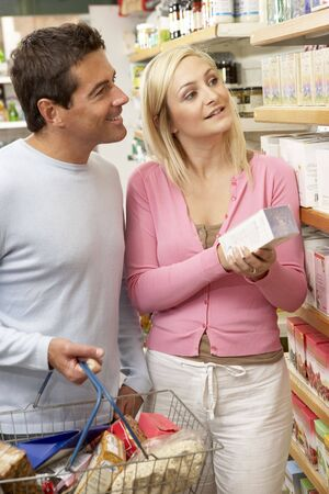 Couple shopping in health food shop photo