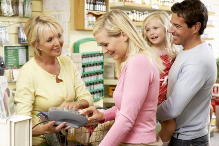 salesperson: Female sales assistant in health food store