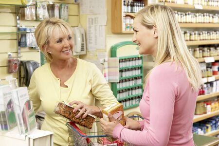 Sales assistant with customer in health food store photo