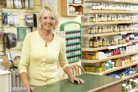 checkout counter: Female sales assistant in health food store