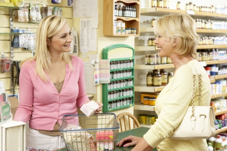 Female sales assistant in health food store photo