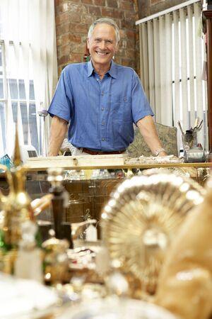 proprietor: Male antique shop proprietor