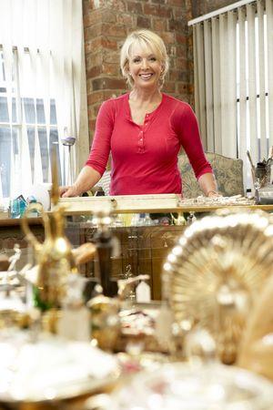 proprietor: Female antique shop proprietor