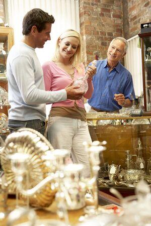 Couple shopping in antique shop photo