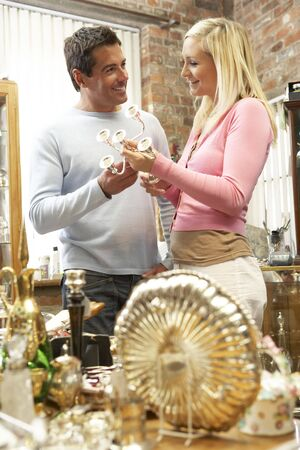 Couple shopping for antiques photo
