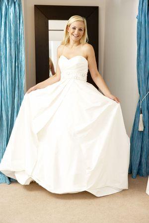 Bride trying on wedding dress photo