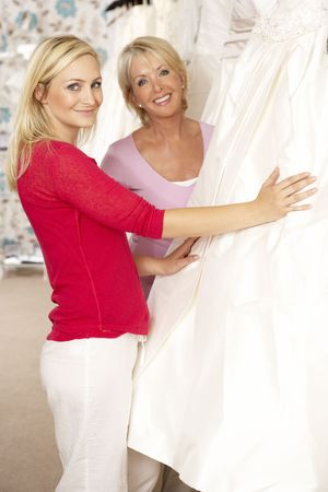 Bride trying on wedding dress with sales assistant Stock Photo - 5633049
