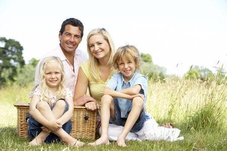 Family having picnic in countryside photo
