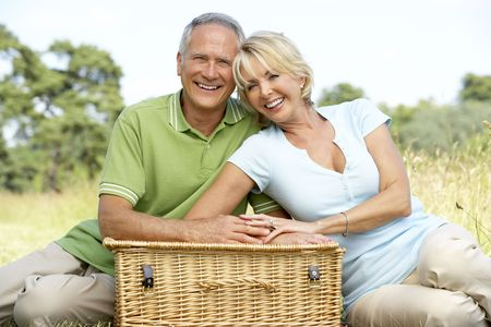 couples outdoors: Mature couple having picnic in countryside Stock Photo