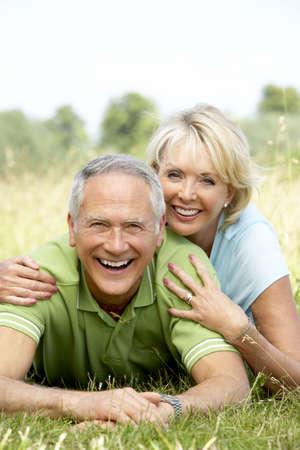 Mature couple having fun in countryside photo