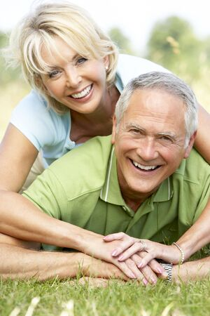 countryside loving: Mature couple having fun in countryside Stock Photo