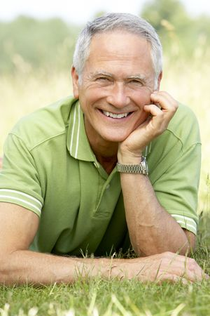 Portrait of mature man relaxing in countryside photo