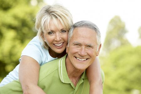 mature couple: Mature couple having fun in countryside Stock Photo