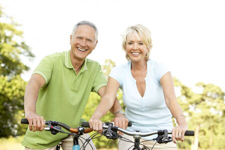 fit man: Mature couple riding bikes