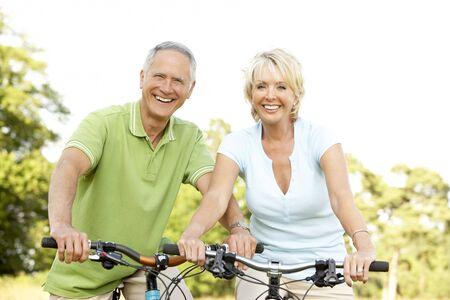fit couple: Mature couple riding bikes