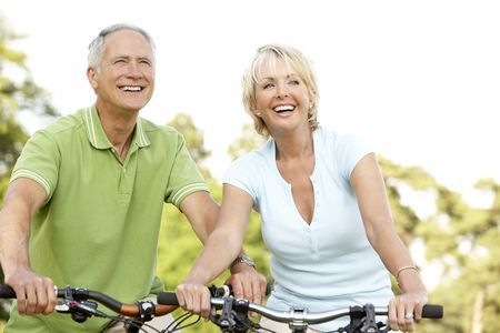 Mature couple riding bikes Stock Photo - 5633227