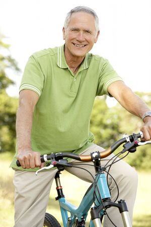 Portrait of man riding cycle in countryside photo
