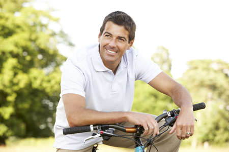 Young man riding bike in countryside Stock Photo - 5633339