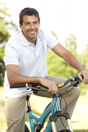 Young man riding bike in countryside Stock Photo - 5633158