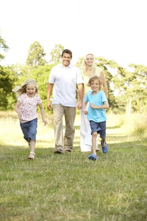 Family having fun in countryside Stock Photo - 5633619