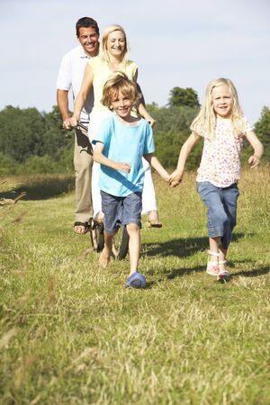 Family having fun in countryside Stock Photo - 5633271