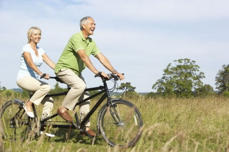 Mature couple riding tandem photo