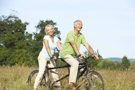 Mature couple riding tandem photo