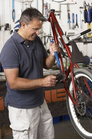 proprietor: Owner of cycle shop in workshop Stock Photo