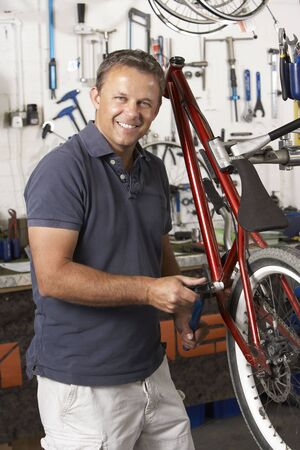 business: Owner of cycle shop in workshop Stock Photo