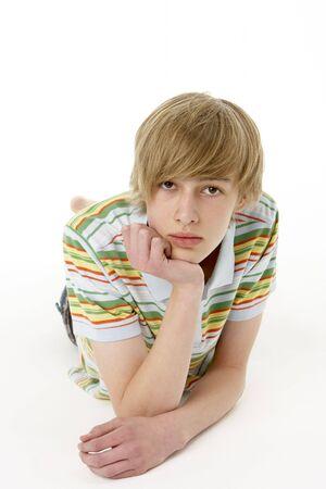 Studio Portrait Of Serious Teenage Boy photo