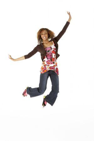 air jump: Full Length Studio Portrait Of Jumping Teenage Girl