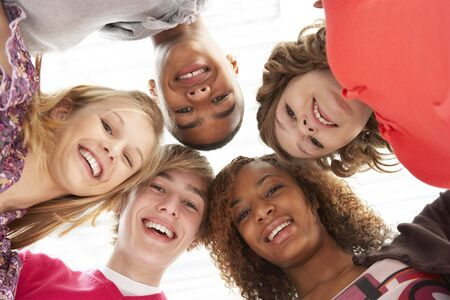 Five Teenage Friends Looking Down Into Camera photo